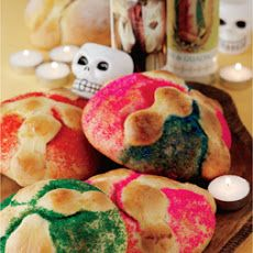 Pan de Muerto is a sweet bread that is shaped to resemble bones and decorated.