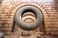 compressed earth block construction using tire to form arch