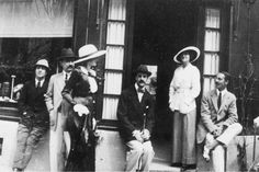 """Gabrielle """"Coco"""" Chanel and Boy Capel in front of Chanel's Deauville Boutique"""