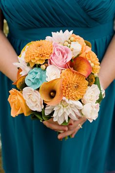 orange & teal. I like the dress color. and the idea of mix and match flowers in the orange family.