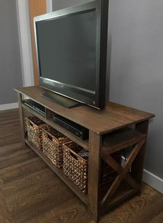 These free TV stand plans will help you build not only a place to sit your TV but also a place to store your connected devices and media. #tvstand #diy #ideas