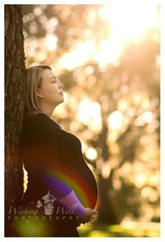 I did a maternity session at a park. J is two weeks away from birth and absolutely lovely! She and her husband were so easy to photograph and up for trying all of my ideas. :) And to the happy couple, enjoy your sneak peek!First, my favorite from the session (a little sunflare and rainbow for…