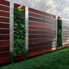 50 Modern Front Yard Designs and Ideas LOVE, LOVE, LOVE this fencing. The stainless on the side of the vertical garden really sets it off. vertical succulent garden on a modern wood fence