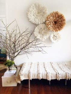 Off White Juju Hats are hanging on the wall and it makes nice decorative pieces and I like the Morrocaan blanks that covers the table : Table Tonic