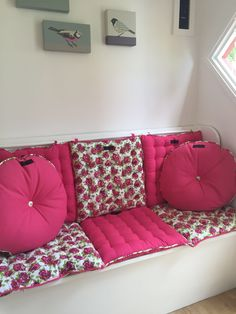 Pink Paddy seat pads and Rolly circular cushions displayed on a girls Wendy House. Click and read the whole story on our blog.