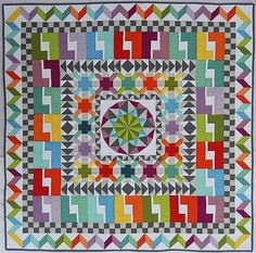 """Members of the have been very busy this fall winning awards. Afton Warrick from the Albuquerque Modern Quilt Guild won the Quilters Newsletter """"Celebrate 45 Years of Quilting"""" Challenge. She had to create a 45″ x 45″ quilt. She titled her entry """"XLV"""". She was the grand prize winner and the prize pack included a 750 Bernina as well as some other goodies."""