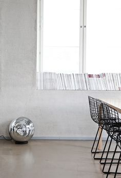 Pared-back interior with the stunning Tom Dixon Mirror Ball Lamp http://www.nest.co.uk/search/tom-dixon-mirror-ball-floor-lamp