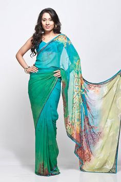 A digital printed saree in georgette fabric, comes with an unstitched crepe-de-chine  blouse piece.