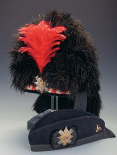 The Black Watch Officer's Feather Bonnet (with red hackle) and Glengarry Cap. Originally established in 1725 and now known as The Black Watch, Battalion, The Royal Regiment of Scotland, the Black Watch was the senior regiment of Highlanders. Scottish Army, British Army, Scottish Dress, Scottish Warrior, Canadian Army, Scottish Kilts, Scottish Highlands, Military Cap, Military Uniforms