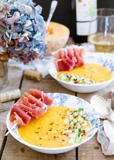 This chilled mango melon soup is garnished with tangy pickled cucumber and prosciutto skewers for a salty, sweet and cool summer dish.