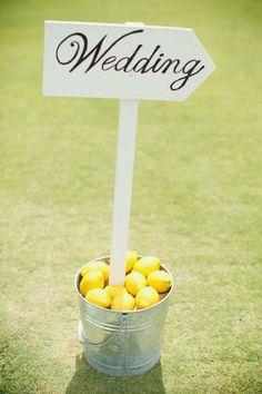yellow beach wedding sign