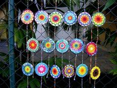 They are upcycled CDs that have colorful crochet mandalas over them ...