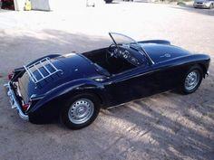 Google Image Result for http://bringatrailer.com/wp-content/uploads/2008/12/1959_MGA_Twin_Cam_Roadster_For_Sale_Rear_1.jpg