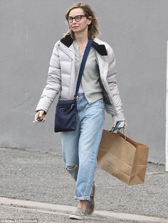 Casual: Calista Flockhart donned ripped jeans and a puffy jacket while out shopping in Los...