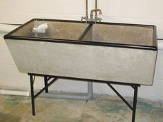 Repurpose a Tub Sink as Dog Wash Station in the Basement