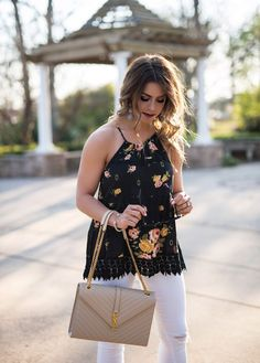 springtime date night, date night, floral black tank, francescas floral top, floral top, white jeans, distressed white jeans, cream envelope purse, baublebar earrings, ysl purse, what to wear on a date night, black and white fashion, what to wear in the spring, spring fashion, spring, spring outfit ideas, here's the skinny by bailey schwartz, bailey schwartz blog, charlotte fashion blogger