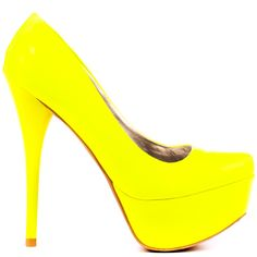 Be the center of attention in this vibrant pump by Veda Soul!  A tantalizing bright neon yellow patent blankets the entire silhouette to create an eye popping presentation.  A tall 5 1/2 inch stiletto heel and 1 1/2 inch closed toe platform create this show stopper.