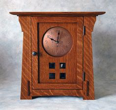 An Arts & Crafts or Mission style clock made of QSWO.
