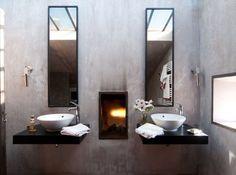 Salle de bain faite de brique, béton teinté et chaux