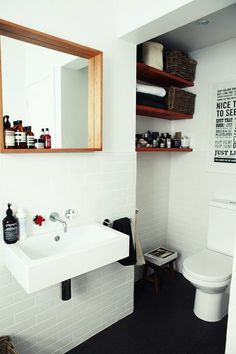modern bathroom - I really like the open shelf idea.  Better than the cabinet my house came with!