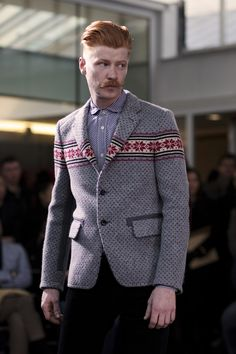I can't take my eyes off this. The ski sweater-blazer.. awesome, the mustache... wowza, the ginger swath of hair.. superb. this whole look is admirably bananas