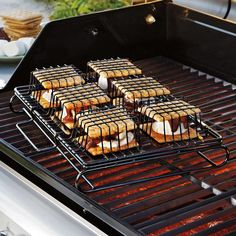 Easily make 6 gooey, delicious s'mores at a time-- they're the ultimate after BBQ dessert!  Our S'Mores Maker lets you whip up 6 gooey s'mores on the grill, in your oven or toaster oven. No more dirty campfires or burnt marshmallows! Just stack and lock your s'mores into the sturdy non-stick rack for perfect s'mores in just 5 minutes, indoors or out! Great for parties and family fun nights. Non-stick rack makes cleanup quick and easy.