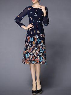 Pretty, feminine, and I like the print. And I like the sheer sleeves.