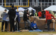 """Members of Story City Methodist Church youth group make a shelter with cardboard boxes during the """"Reggie's Sleepout"""" event at Jack Trice Stadium Saturday, March 25, 2017, in Ames, Iowa. Photo by Nirmalendu Majumdar/Ames Tribune http://www.amestrib.com/news/20170325/community-braves-cold-rain-for-youth-homelessness-at-reggie8217s-sleepout"""