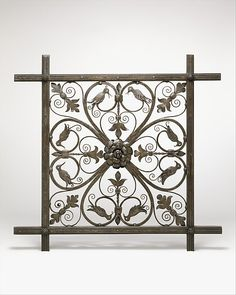 This full-scale prototype of one unit of the large, decorative grille for the Annex of the Pierpont Morgan Library exhibits Yellin's total mastery of his medium—iron—which is crafted here into graceful, Renaissance-inspired filigrees