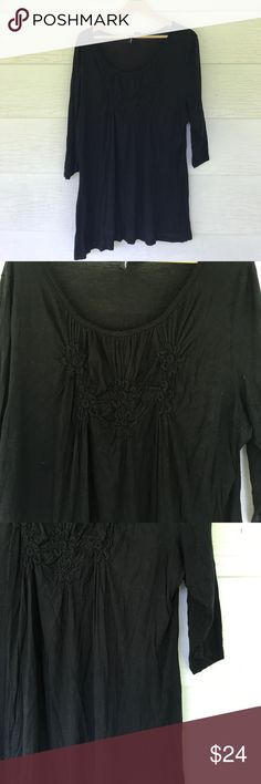Black blouse Black quarter length sleeve blouse. Pretty details on bust. Round neck. Size 2x. 25 bust 31 length. All measurements are approximate St. Tropez Tops
