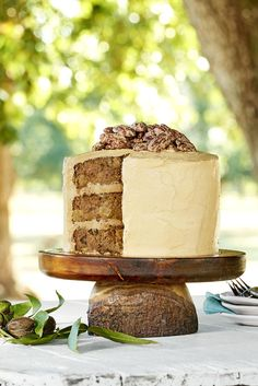 Topped with a salted caramel frosting and candied pecans, this apple-cinnamon layer cake is absolutely indulgent.  #easyrecipe #recipe #food #ideas #dessert #comfortfood #inspiration