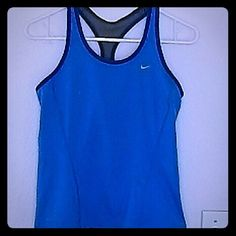 NWOT Nike Dri Fit Top! Turquoise bluish color body with navy blue accents at the shoulders. Size medium. Built in bra. Reflective strps  on the back for running and walking  in the dark!  Just noticed a tiny nic on the inside of the bra. Must have bought it that way. Who cares? It's  a super cute top!  I love it, but bought a size too big.  Seriously, you'll love it! Nike Tops