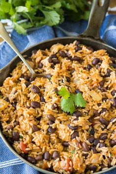 Nadire Atas on Spanish Food Today I am sharing a super easy Spanish Rice with Beans recipe that we love and make again and again. The boys love this recipe and they even help me throwing all of the ingredients in the skillet. Spanish Rice And Beans, Rice With Beans, Black Beans And Rice, Beans Beans, Rice And Beans Recipe Vegetarian, Mexican Beans And Rice, Rice And Bean Soup Recipe, Mexican Beans Recipe, Mexican Brown Rice