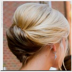 Picture only.  Soft updo for someone with mid length, not too thick hair