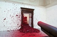 Shooting into the Corner' Anish Kapoor. A pneumatic compressor shoots 11-kilogram balls of wax at 20-minute intervals into the corner across the room; all in all, 20 tons of wax were 'fired away' throughout the exhibition run in 2009.