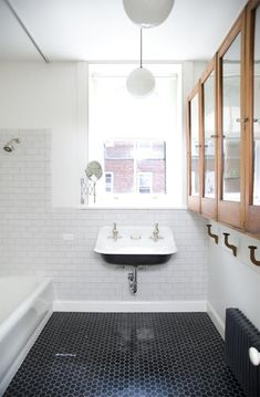 This mix of subway tile on the walls and penny tile on the floor is era appropriate for our house. And the sink is adorable. (Can sinks be adorable?)