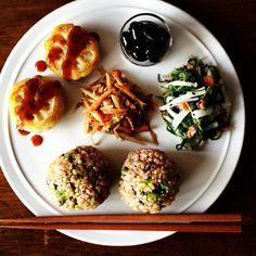 Rice balls, fried burdock root, and black beans, with plum radish, lotus root, and Oka hijiki. photography by Kei Yamazaki