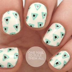 This geometric manicure from Alice of One Nail to Rule Them All uses repeated triangles for the perfect summer nails effect. See 15 of our favorite nail designs here! #nailart #summernails