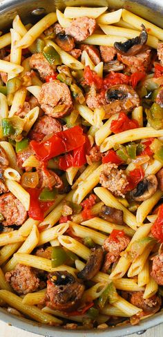 Italian Sausage Pasta with Vegetables. Italian sausage is seared with bell peppers, mushrooms, onions, fresh tomatoes in cajun spices, with a splash of red wine! Topped with freshly grated Parmesan cheese!