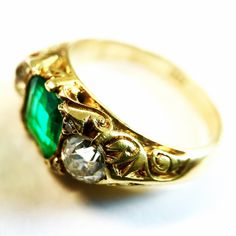 We just love the detailed scroll work on this antique 3 stone ring bought in our Hong Kong office.