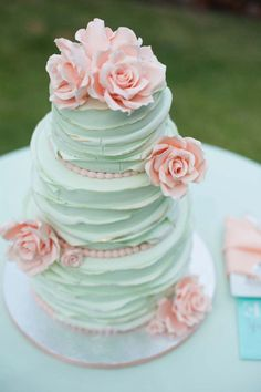 Mint colored wedding cake. LOVE the the flower petal effect on the frosting!♥ (Not so sure about the roses, though.)