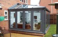 Arena Conservatories is a trusted conservatory company in Telford, Shropshire. For professional conservatory installation and more, get in touch with us for a free quote. What Is A Conservatory, Modern Conservatory, Conservatory Extension, Conservatory Kitchen, Garden Room Extensions, House Extensions, Outdoor Rooms, Outdoor Living, Future House