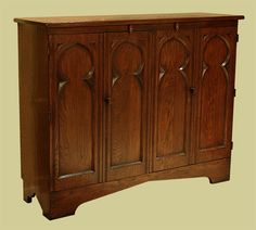 Oak TV cabinet Gothic style with bi-fold doors. Oak Tv Cabinet, Tv Cupboard, Tv Stand Cabinet, Low Cabinet, Oak Cabinets, Cabinet Doors, Cupboards, A Frame House Plans, Oak Panels