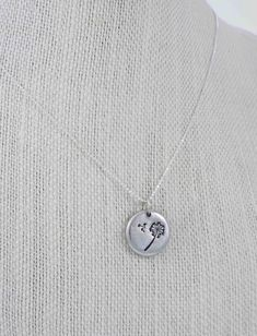 A Dandelion Puff is hand stamped, by me, onto a 5/8 of an inch pewter pebble. Each individual pewter pebble is hand poured. Each pebble has its
