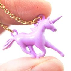 A necklace featuring a small unicorn pendant in a lovely pale purple color! The pendant measures 2 cm tall by 3 cm wide and hangs on a 16 inch (41 cm) long gold chain.  Made with enamel plated brass! More colors available in our store!  --- Handling time: - Please allow two to three busines...