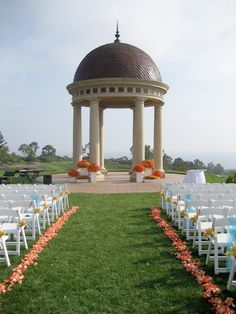 Beautiful wedding at the Resort at Pelican Hill Newport Beach, CA. White boxes filled with roses, orchids and protea were brought into the reception after the ceremony. Coordination by Laurie Davies of Five Star Weddings and  Events.