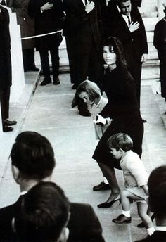 Jackie glances wistfully at an acquaintance as she accompanies the coffin of her late husband into the Capitol Rotunda, with her children, 11/24/63.