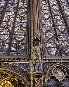 Apostle and windows, Upper Chapel The splendid stained glass windows of the chapel of Sainte-Chapelle which was reserved for the royal family and court. -- Paris, France