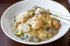 Creamy chicken stroganoff with earthy mushrooms spooned generously over top of buttery egg noodles
