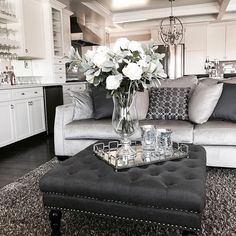 Sharing our living room decor. Open floor plan. Built in wet-bar. Box ceiling. Grey, white, and black color scheme. Ottoman with mirror tray. Neutral decor theme. Home decor. Home design.